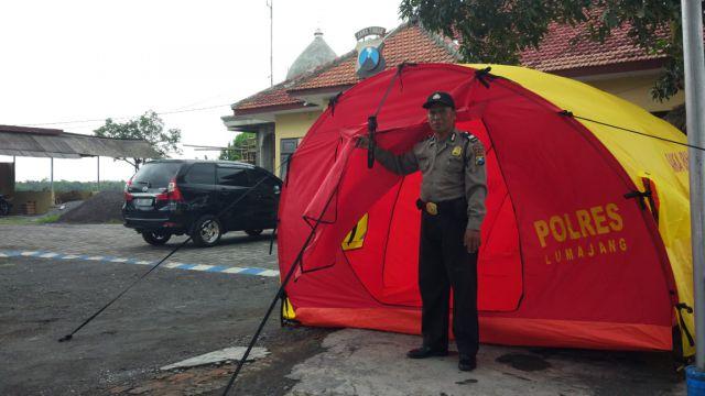 Polsek Rowokangkung Mulai Dirikan Tenda Pengungsi Korban Banjir