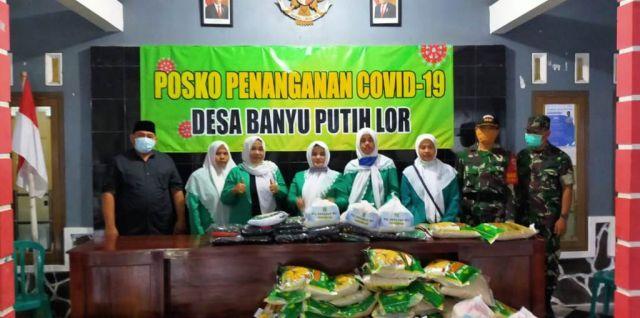 Fatayat NU Lumajang Berikan Sembako 2 Desa Terdampak Covid 19